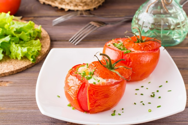 Fresh tomatoes baked with cheese and chicken egg