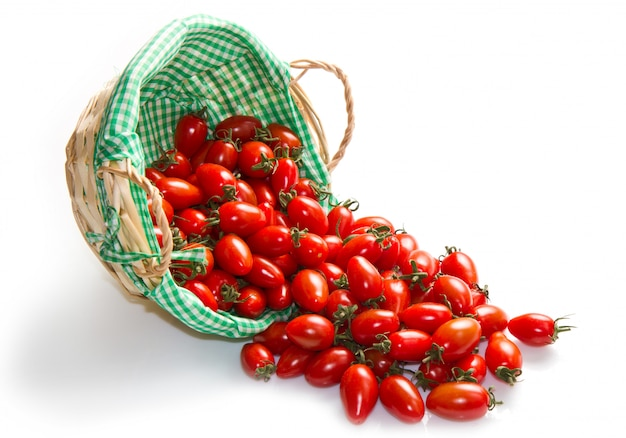 Fresh tomatoes in basket on a white