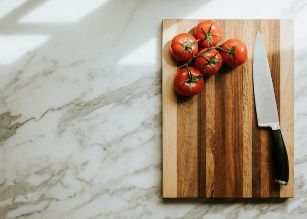 Fresh tomatoes on a cutting board