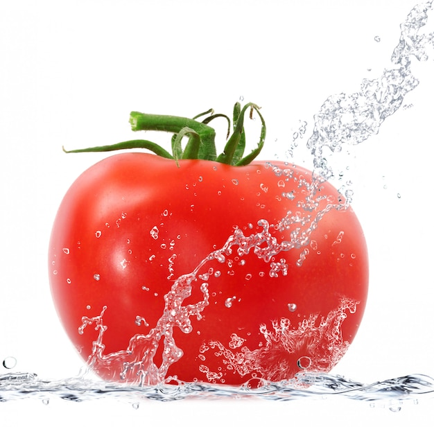 Fresh tomatoes falling in water