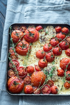 Fresh tomatoes, feta, garlic and thyme on the tray