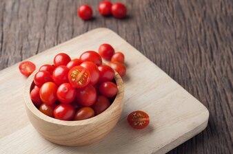 Fresh tomatoes on wood table.