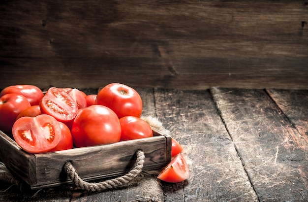 Fresh tomatoes on a tray. on a wooden background.