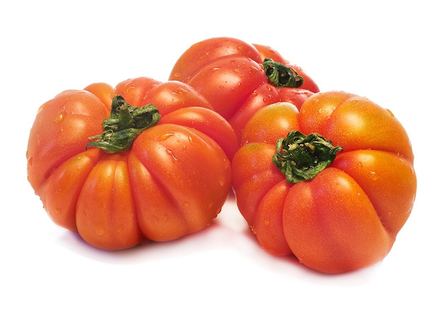 Fresh tomatoes over white background