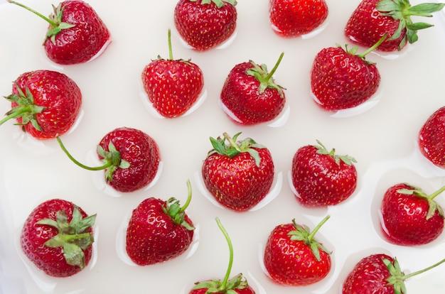 Fresh trawberries on liquid background