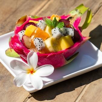 Fresh tropical fruit salad in dragon fruit
