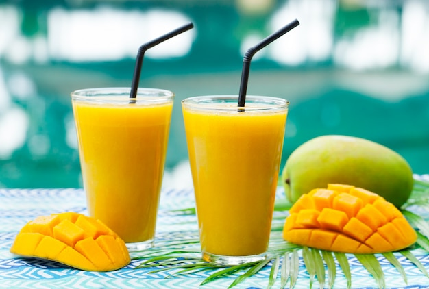 Fresh tropical fruit smoothie mango juice and fresh mango