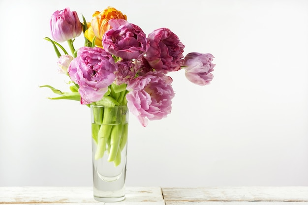 Fresh tulip flowers bouquet in cup