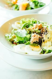 Fresh tuna salad in white bowl