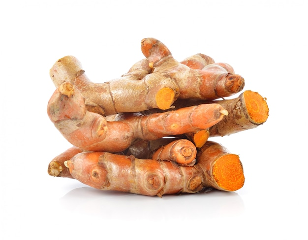 Fresh turmeric roots isolated on white