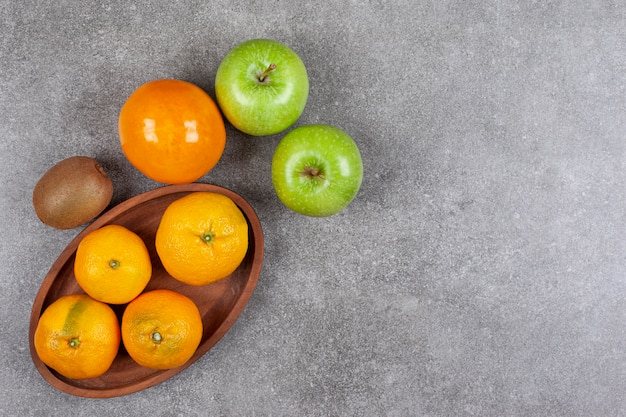 Fresh various fruits on a wooden kitchen board