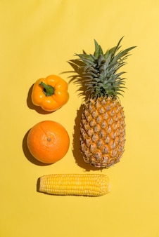 Fresh various fruits on yellow background