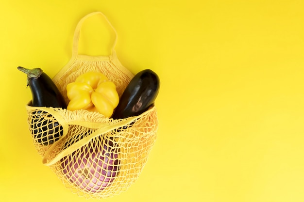 Fresh vegetable, garden produce, clean eating and dieting concept. vegetable in a net cotton bag