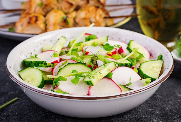 Fresh vegetable  radish and cucumber salad with green onions and microgreens peas