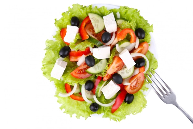 Fresh vegetable salad with fork isolated on white background