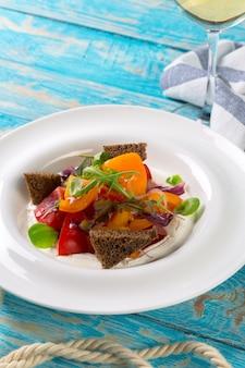 Fresh vegetable salad on wood