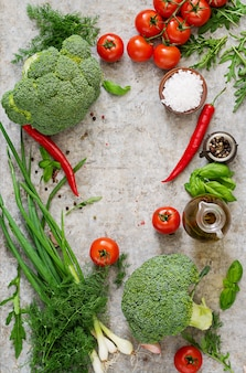 Fresh vegetables - broccoli, cherry tomatoes, chili peppers and other ingredients for cooking. proper nutrition. top view