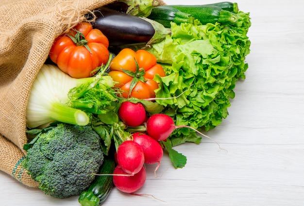 Fresh vegetables in a burlap sack