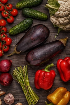 Fresh vegetables for cooking on dark wooden background