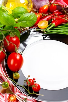 Fresh vegetables and empty plate