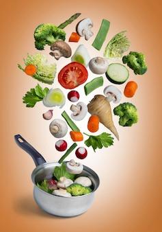Fresh vegetables flying isolated on orange background