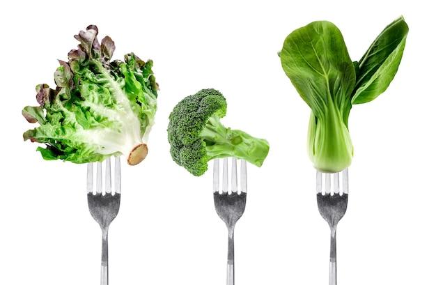 Fresh vegetables on fork
