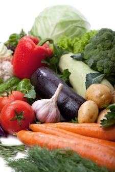 Fresh vegetables fruit on white