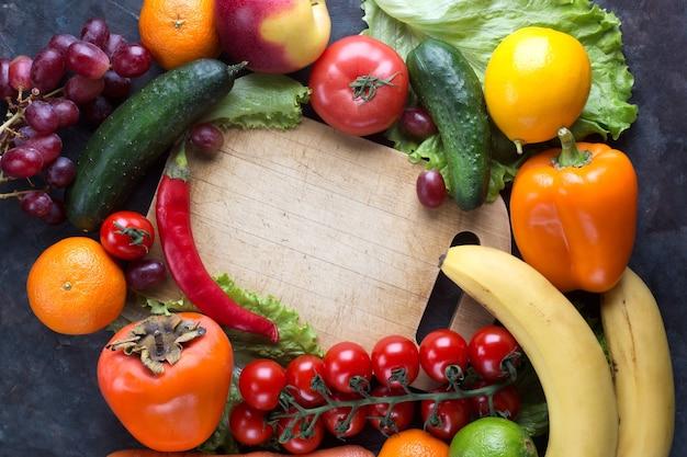 Fresh vegetables and fruits on black