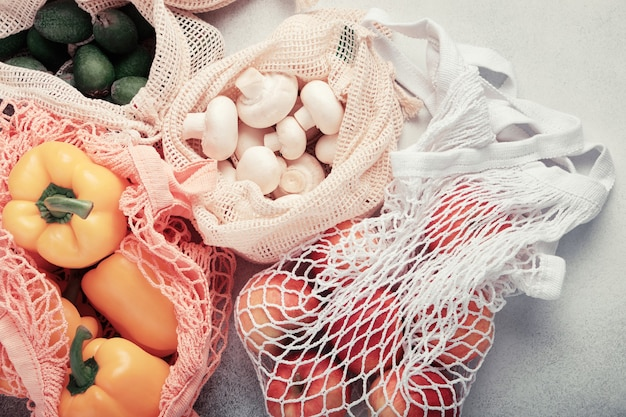 Fresh vegetables and fruits in eco bags.