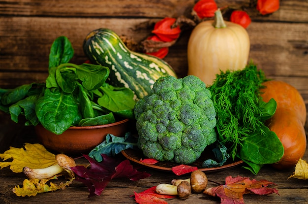 Fresh vegetables and herbs on wooden background