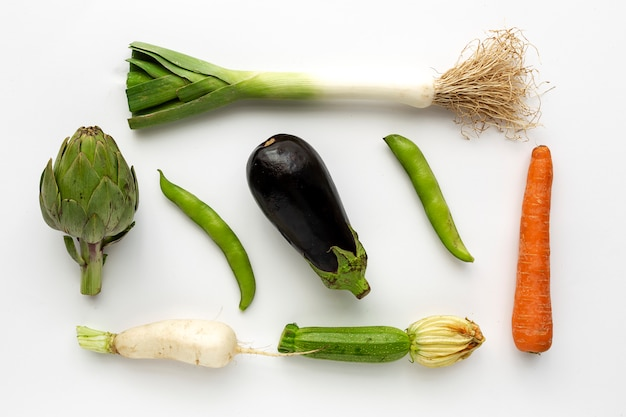 Fresh vegetables knolling composition on white background