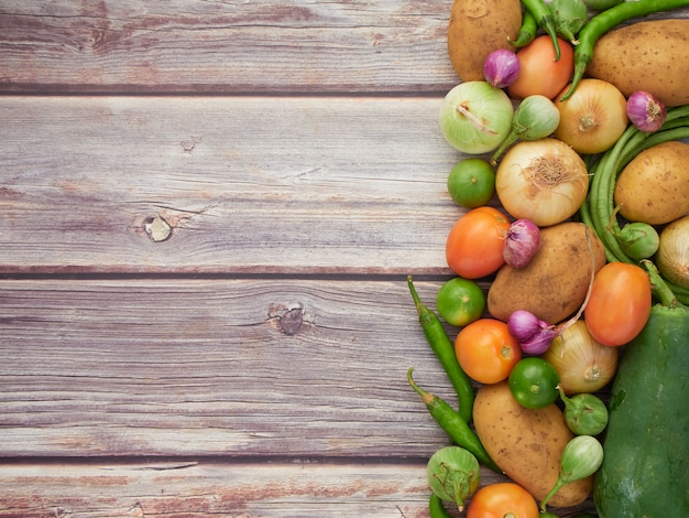 Fresh vegetables on the old wooden table, top view