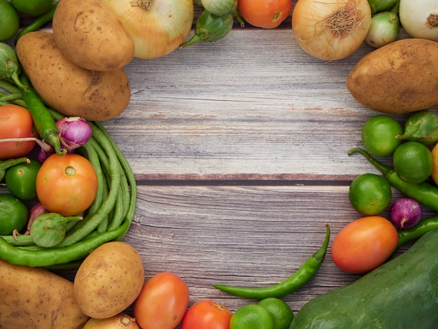 Fresh vegetables on the old wooden table