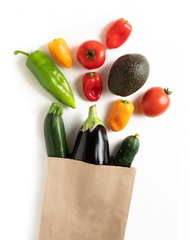 Fresh vegetables in recyclable paper bag isolated