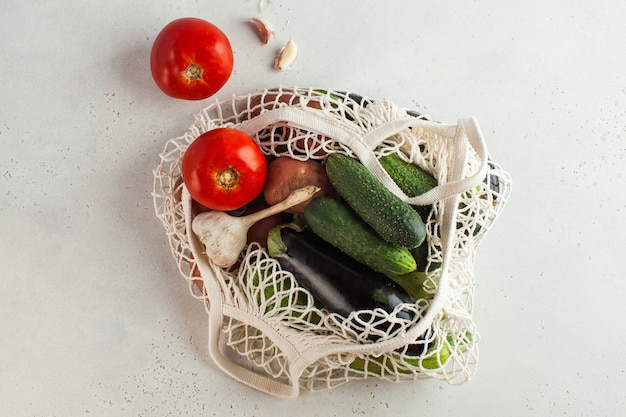 Fresh vegetables in a string bag, environmentally friendly product. concept of harvesting, farming. seasonal vegetables.