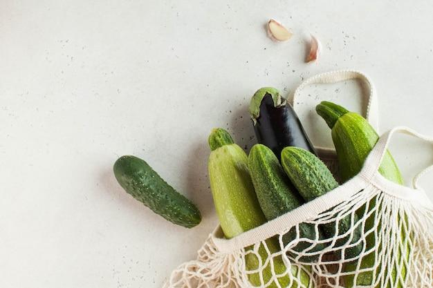 Fresh vegetables in a string bag, environmentally friendly product. harvest. seasonal vegetables.
