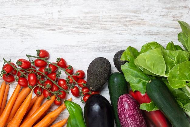 Fresh vegetables on vintage white wooden background