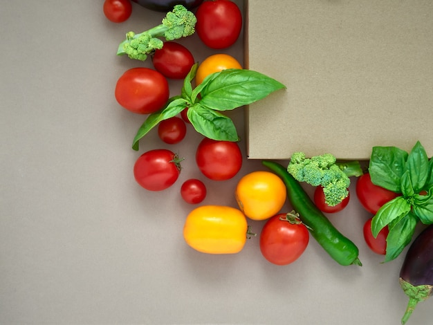 Fresh vegetables on white, top view