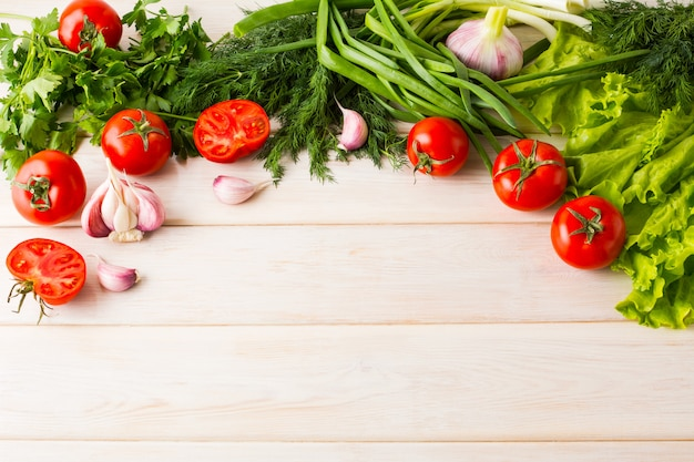 Fresh vegetables on the white wooden background