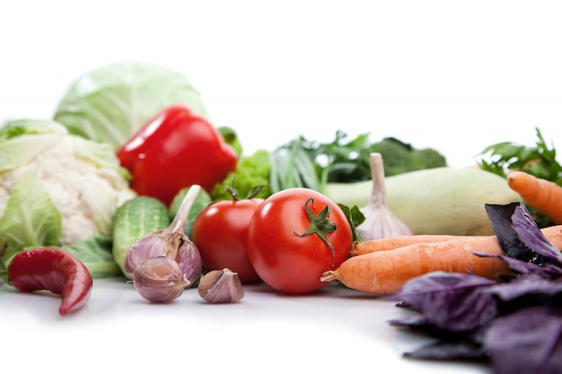 Fresh vegetables on white.