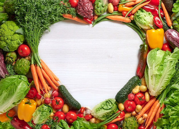 Fresh vegetables with heart shaped copy space