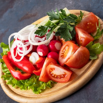 Fresh vegetables on wooden board. closeup