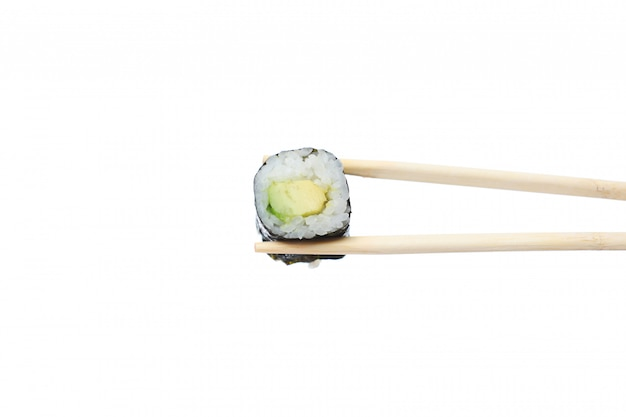 Fresh vegetarian maki sushi roll with wooden chopsticks isolated on white