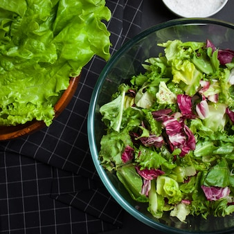 Fresh vegetarian salad mix in a clear glass bowl.