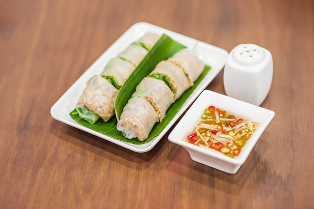 Fresh vietnamese rolls with vegetables on wooden