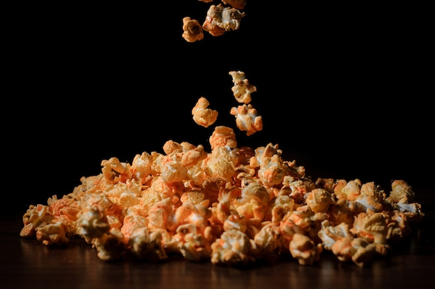 Fresh and warm salty popcorn with cheese