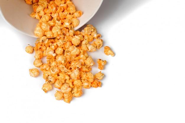 Fresh and warm tasty salt popcorn in a white paper bucket