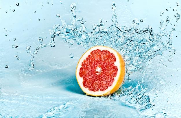 Fresh water splash on red grapefruit