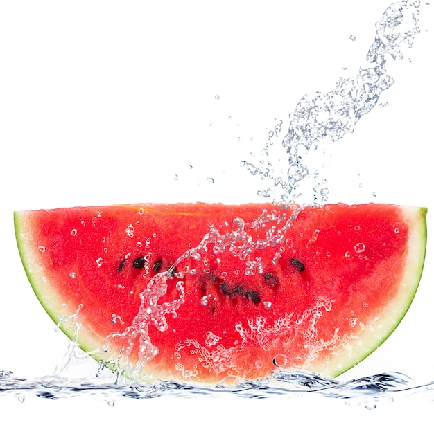 Fresh watermelon falling in water