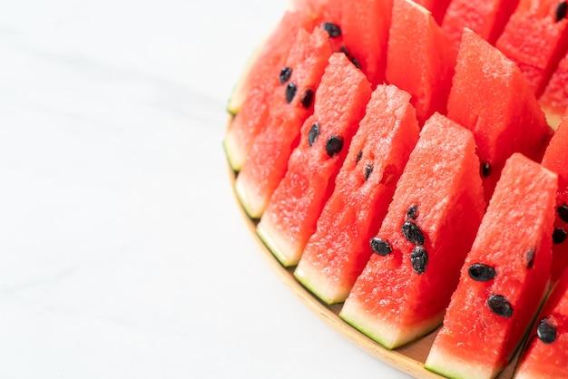 Fresh watermelon sliced on wooden plate